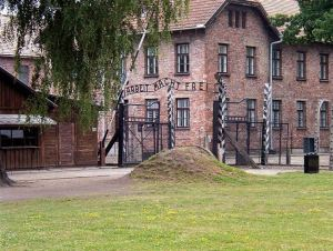 """The entrance to Auschwitz, with the 'welcoming' sign: 'Arbeit Macht Frei', """"Work Shall Make You Free"""""""